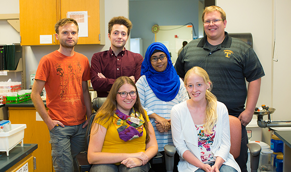 Group Lab Photo: (pictured left to right, top to bottom) Marcin, Nicholas, Meher, Sarah, Bethany