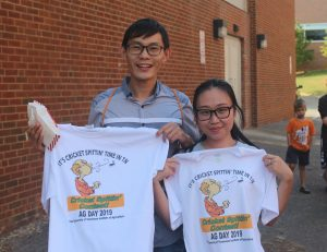 Participants of the Cricket Spitting Contest get a free T-shirt
