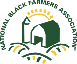 Logo for the National Black Farmers Association: a small green farm with a sunrise behind it.