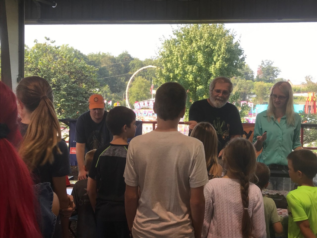 Dr. Grant, Matthew Longmire, and Kassie Hollabaugh at the Tennessee Valley Fair educating the youth on entomology